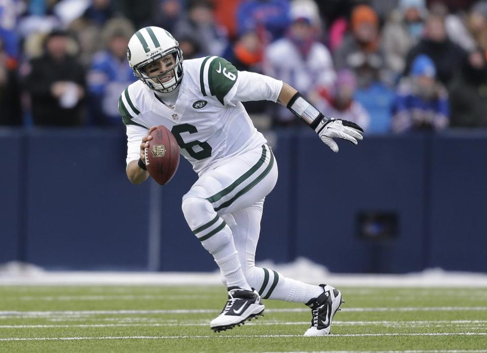 ''Until I'm told differently, I'm a Jet,'' Mark Sanchez said as the Jets cleaned out their lockers.