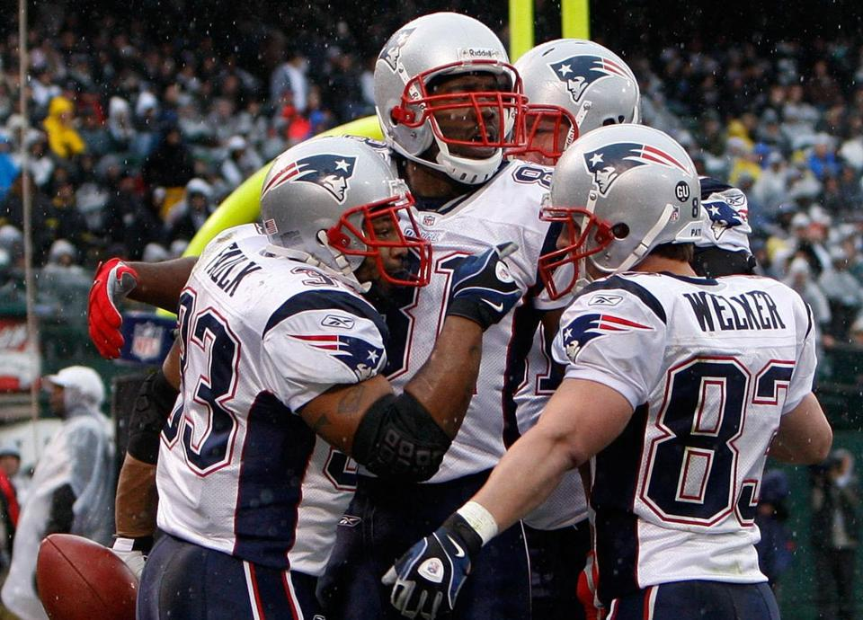 Kevin Faulk, left, drew congratulations after scoring the Patriots' first touchdown.