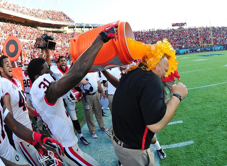 Georgia coach Mark Richt is hit with a shower of Gatorade by Chris Conley after the Bulldogs defeated Nebraska, 45-31, in the Capital One Bowl.