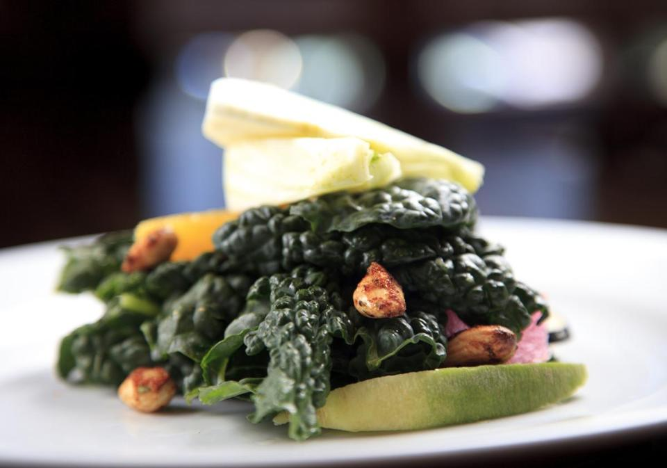 At BoMA Restaurant + Bar in the South End, kale, mesclun greens, and shaved fennel salad.