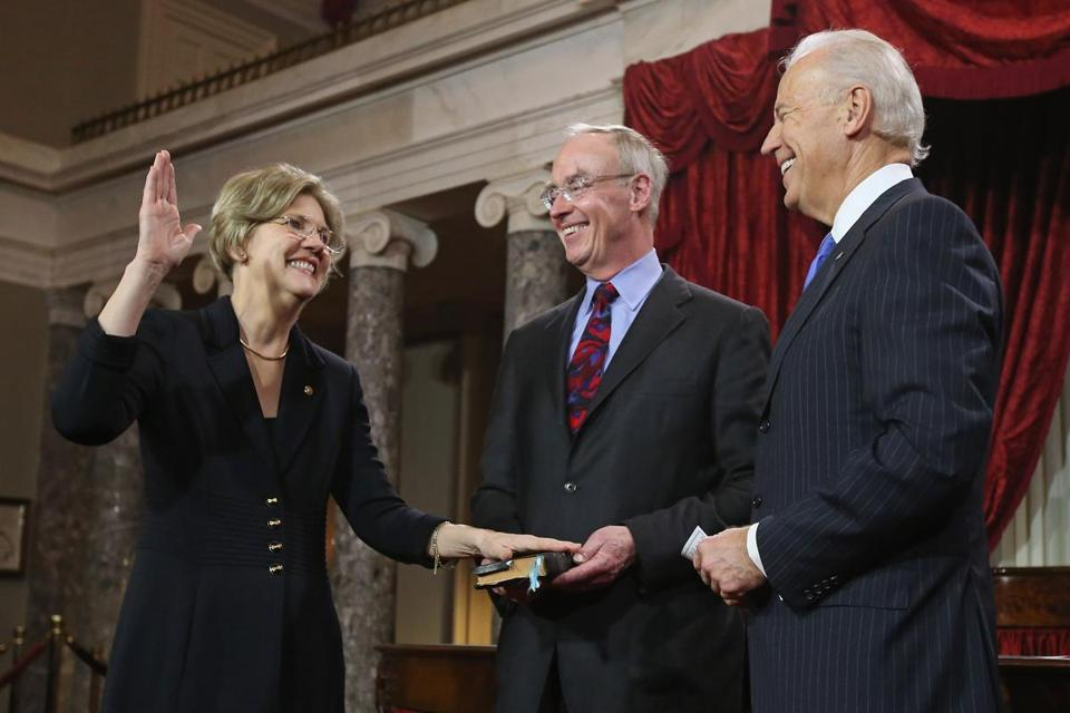 Sen. Elizabeth Warren participated in a reenacted swearing-in with her husband, Bruce Mann and Vice President Joe Biden  at the Capitol.