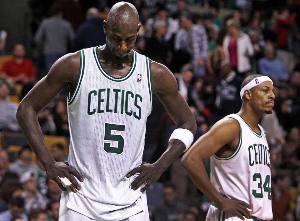 Celtics Kevin Garnett and Paul Pierce have nothing to smile about late in the fourth quarter of a loss to the Grizzlies at the Garden.