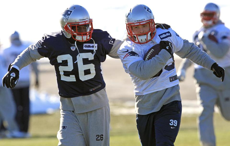 Derrick Martin (left) was cut by the Patriots at the end of training camp, but got a second chance with the team.