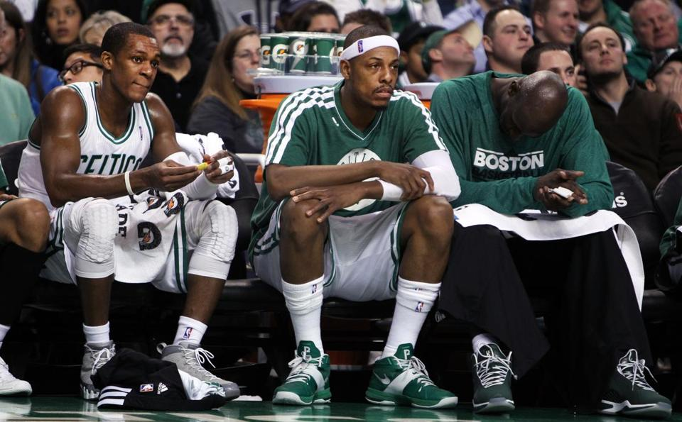 Rajon Rondo, Paul Pierce, and Kevin Garnett, left to right, watched from the bench late in the third quarter of Wednesday night's loss.