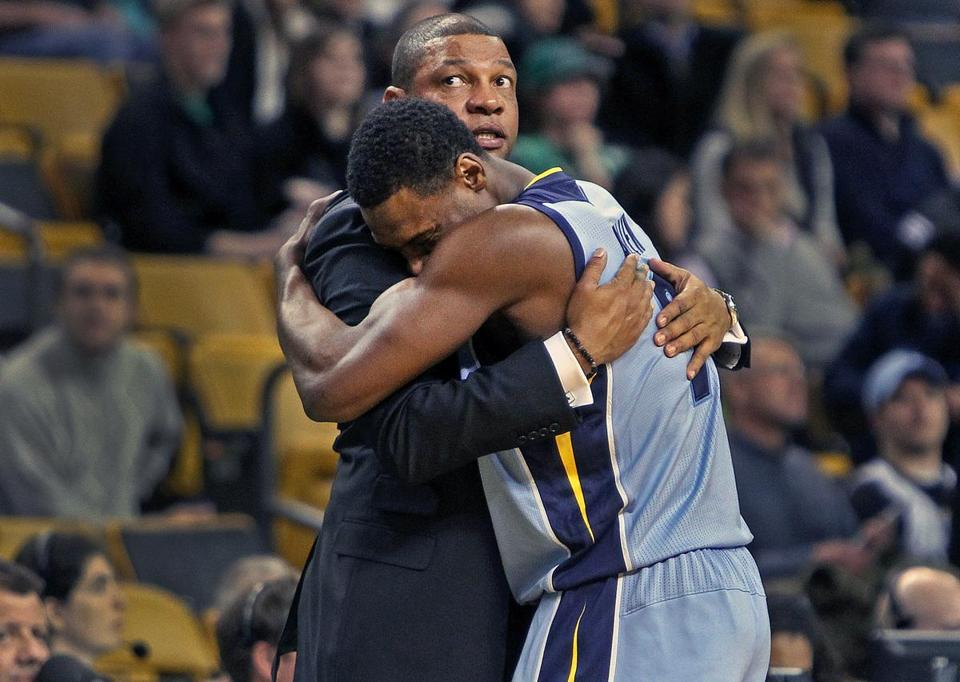 Grizzlies guard Tony Allen has a big hug for his former coach, Doc Rivers, as the final seconds tick off the clock.