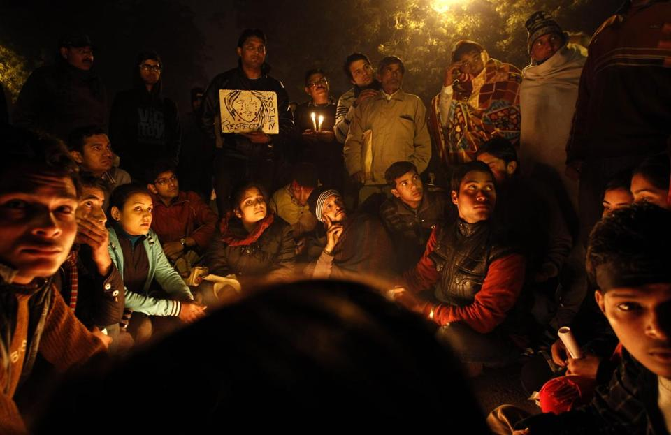 Indians gathered for a candlelight vigil for the victim of a gang rape who died from injuries sustained in the attack.