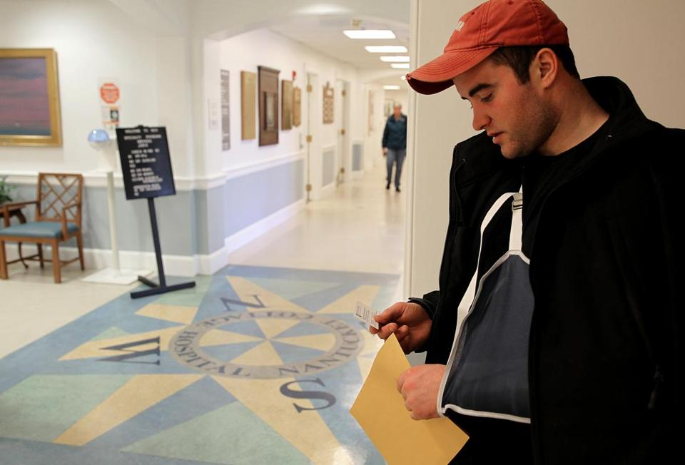 Matthew O'Neill waited for a taxi after being treated for a broken arm at Nantucket Cottage Hospital.