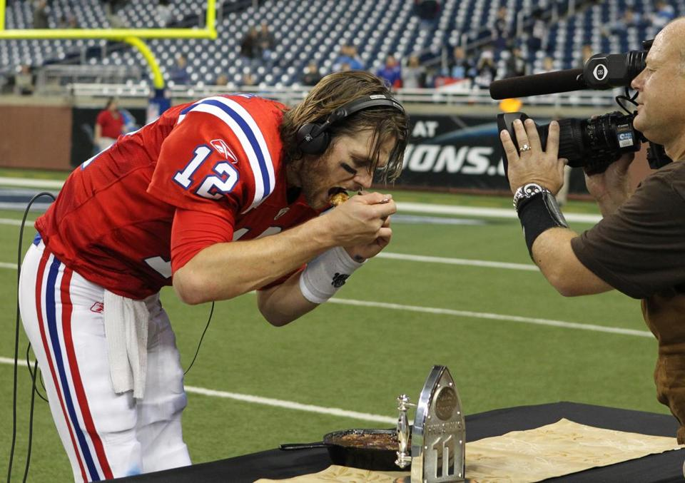Tom Brady sampled some pie after the game after being awarded an TV honor for his performance in the win.