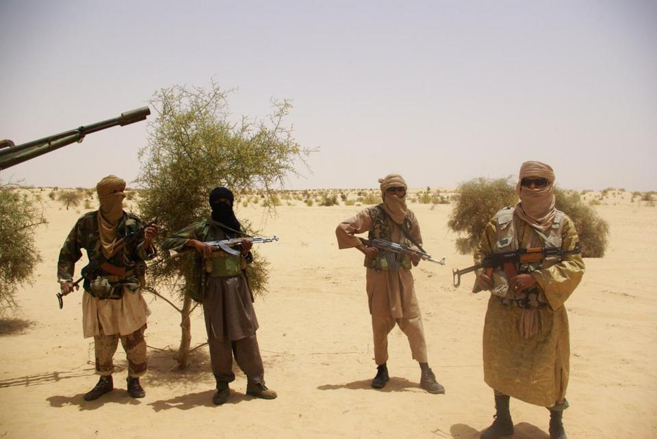 Fighters from the Islamist group Ansar Dine stood guard during a hostage handover near Timbuktu, Mali. Al Qaeda and its allies have taken advantage of political instability.