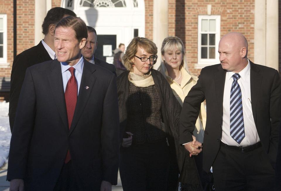 Senator Richard Blumenthal, former Representative Gabrielle Giffords and her husband, former astronaut Mark Kelly, leave the Newtown Municipal Building in Newtown, Conn.