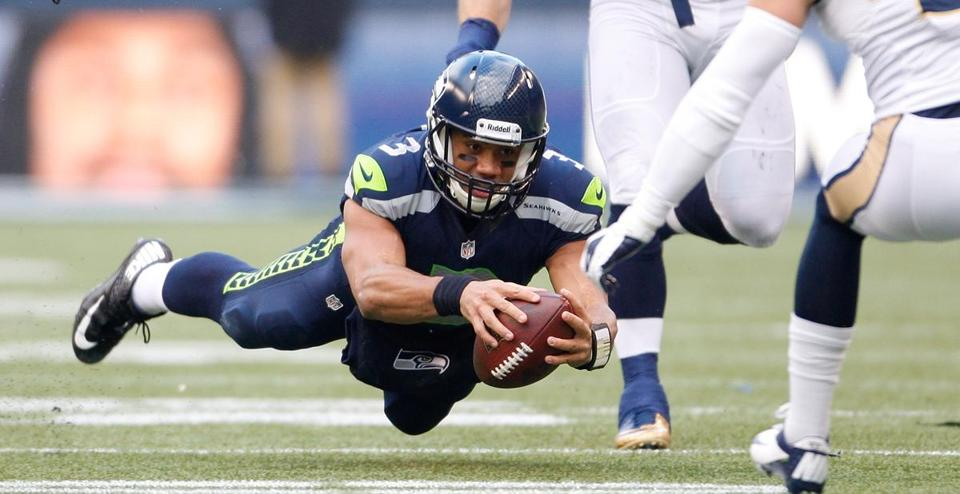 In addition to his passing exploits, Seahawks quarterback Russell Wilson has rushed for nearly 500 yards, and 4 TDs.