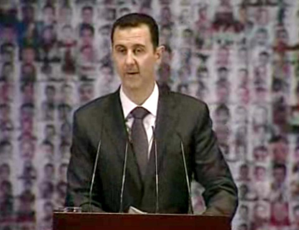 In this image taken from video, Syrian President Bashar Assad spoke at the Opera House in Damascus.