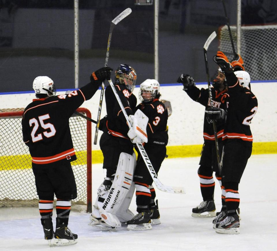 Beverly's Kevin Lally (No. 3, center) hugged goalie Tim Birarelli amid the celebration of the team's 3-0 win over Danvers last Saturday at Salem State College.
