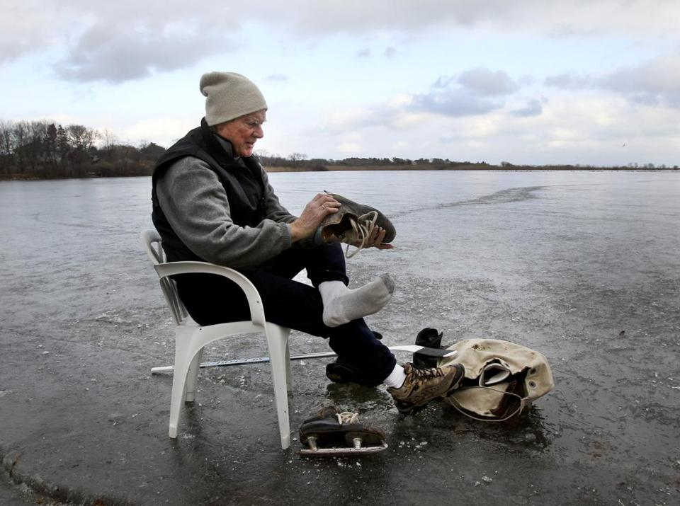 A chair on the ice provided a convenient place for Laurie Hawkins of Rockport to change out of his skates at Gloucester's Niles Pond.