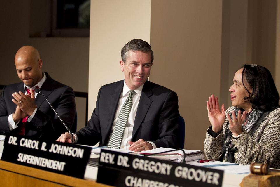 Michael D. O'Neill smiled after he was elected the new chairman of the Boston School Committee. At right is Superintendent Carol Johnson and at left is committee member John Barros.