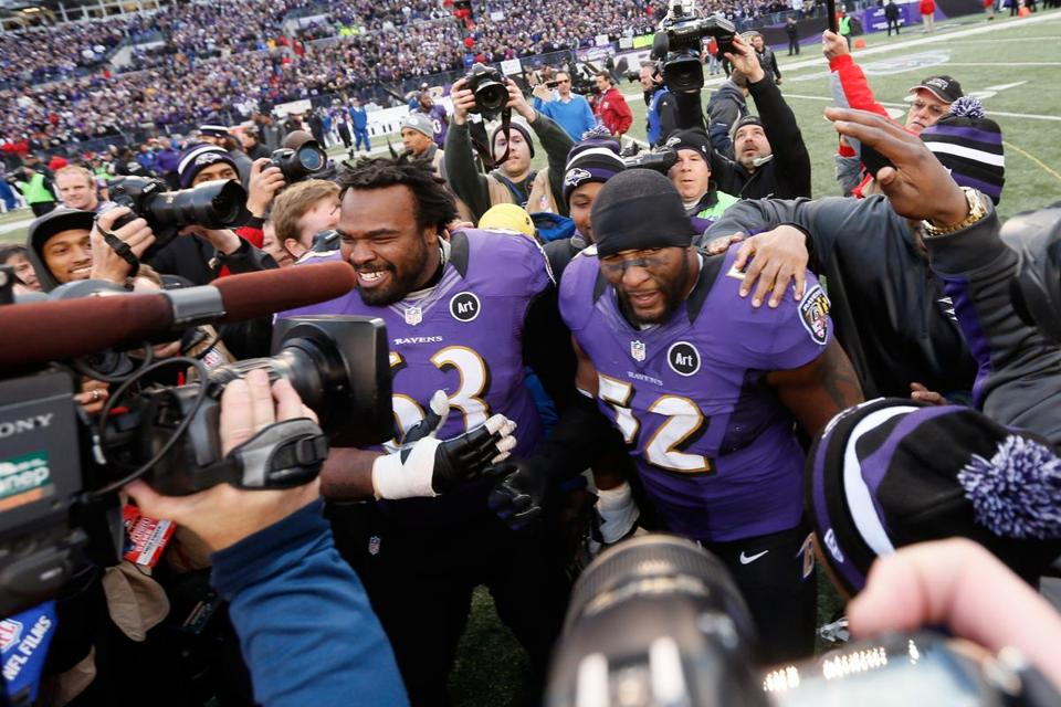 Bobbie Williams (63) and Ray Lewis (52) were at the center of the celebration (top) after the Ravens beat the Colts in an AFC wild-card game in Baltimore.