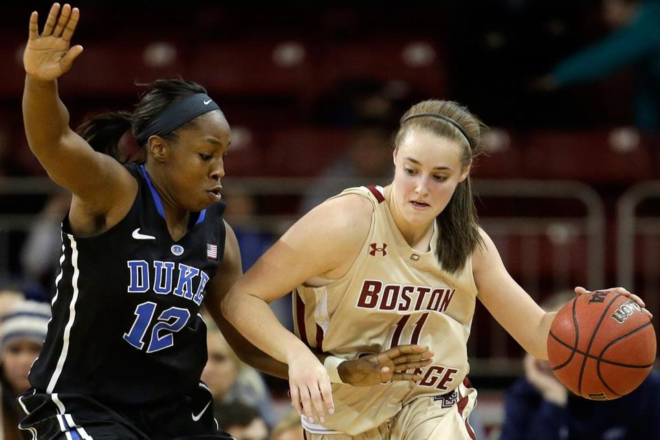 Duke's Chelsea Gray, who tied an ACC record with her second triple-double (18 points, 11 rebounds, 10 assists), puts the clamps on BC freshman guard Nicole Boudreau.