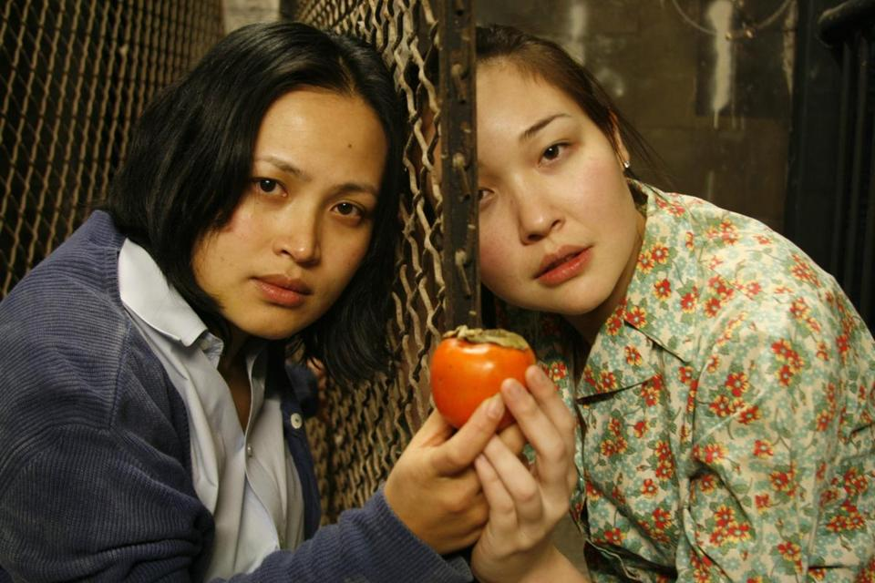 "Giselle Ty (left) and Jordan Clark play sisters contemplating fleeing their repressive country. Playwright Mia Chung, the daughter of South Korean immigrants, says, ""It was important . . . to make those North Korean characters as accessible as possible."""