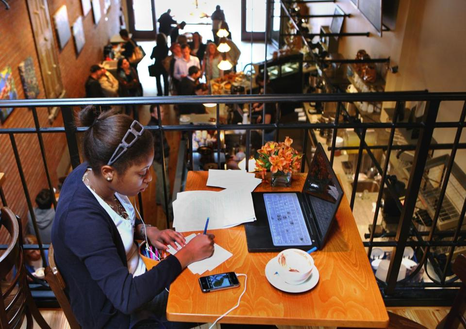 A Harvard student sat in the balcony at Crema Cafe in Harvard Square in May 2008.