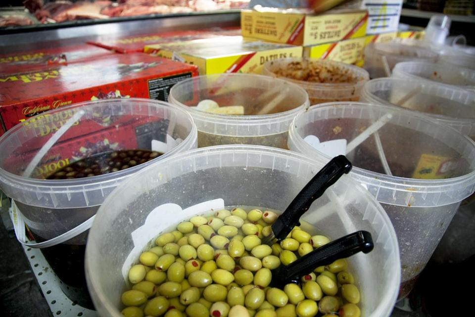 A variety of olives are for sale at Garden Halal Market, a Mediterranean specialty store.