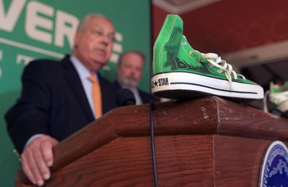 Converse's move from North Andover was made official yesterday at a conference with Mayor Thomas M. Menino.