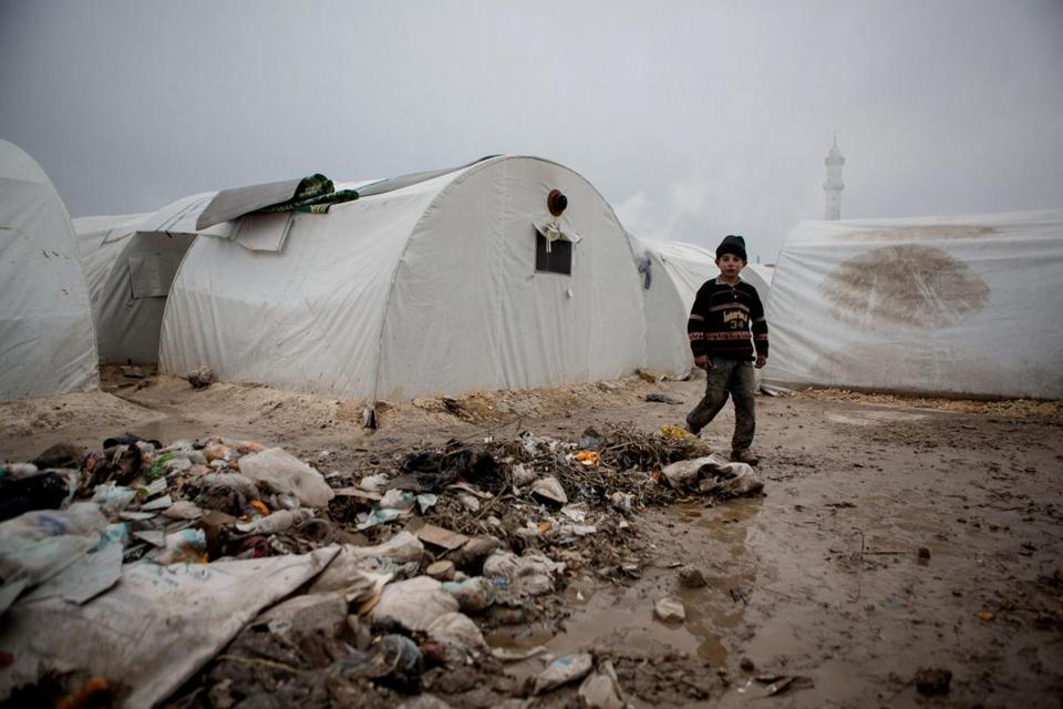Rain and falling temperatures made life miserable Tuesday for about 7,000 people in a refugee camp near the Syrian town of Azaz near the Turkish border.