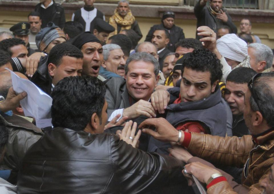 Tawfiq Okasha, a TV presenter accused of insulting President Mohammed Morsi, was acquitted Tuesday in Cairo.