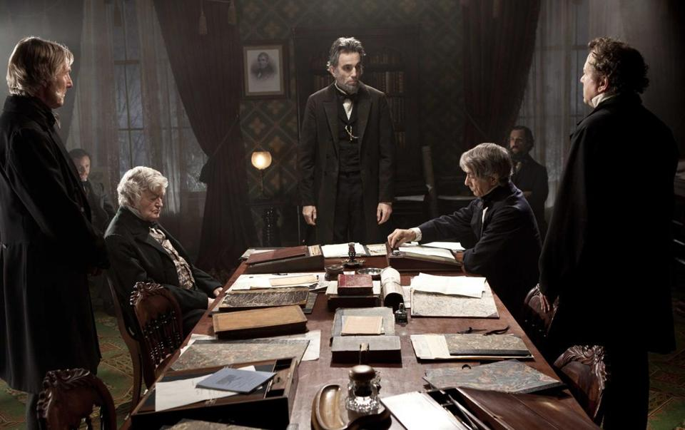 "Daniel Day-Lewis, center rear, as Abraham Lincoln, in a scene from the film, ""Lincoln."""
