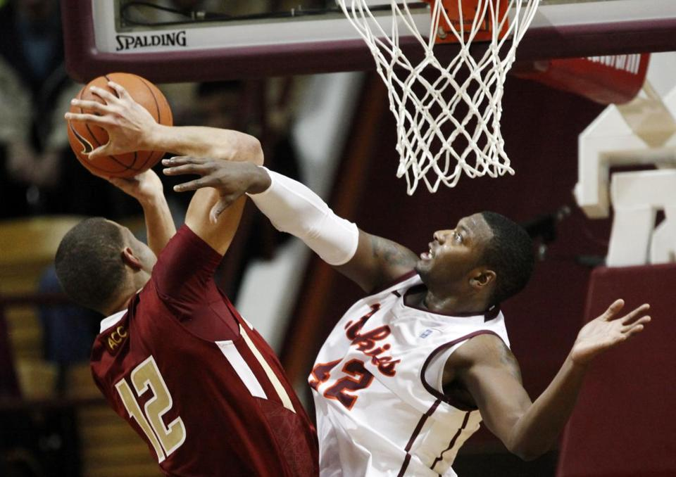 BC's Ryan Anderson, who finished with 26 points, runs into Virginia Tech's C.J. Barksdale on his way to the hoop.