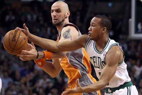 The Celtics' Avery Bradley (right) swooped in and stole the ball out of the hands of the Suns' Marcin Gortat in the first quarter. The Boston Celtics hosted the Phoenix Suns in a regular season NBA game at the TD Garden.