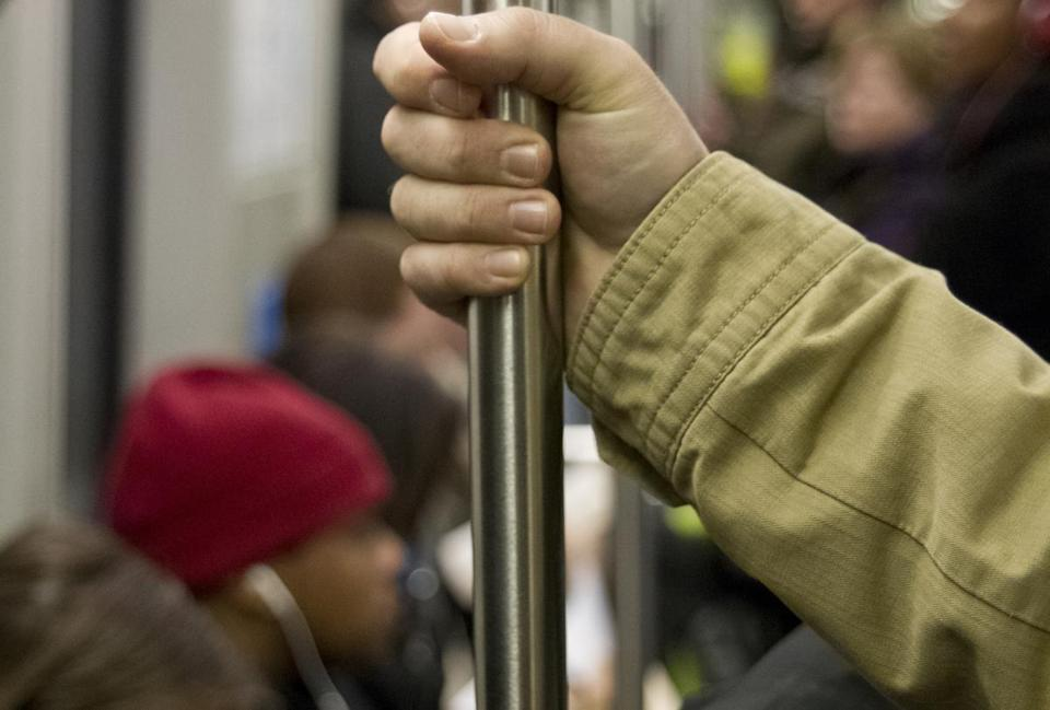 MBTA riders are thinking twice before they touch potentially germ-covered poles on trains.