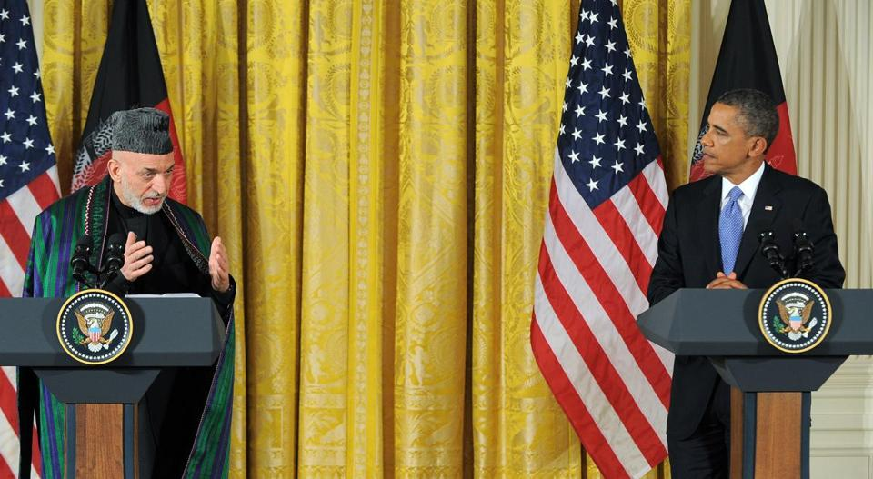 US President Barack Obama listensed as his Afghan counterpart Hamid Karzai spoke during a joint press conference in the East Room at the White House in Washington, DC, on January 11, 2013.