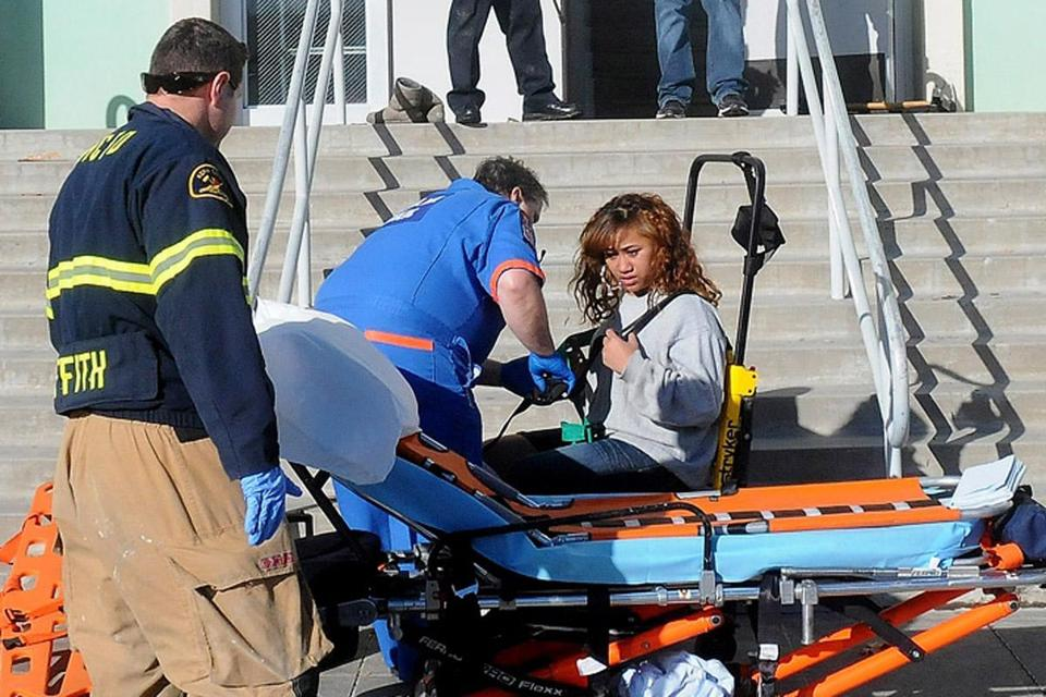 Paramedics assisted a student following a shooting on Thursday at a rural high school in Taft, Calif. A teacher and a school official talked the gunman into surrendering.