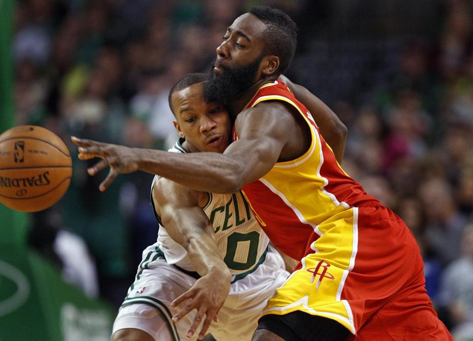 Celtics point guard Avery Bradley and Houston Rockets shooting guard James Harden grappled for the ball Firday night.