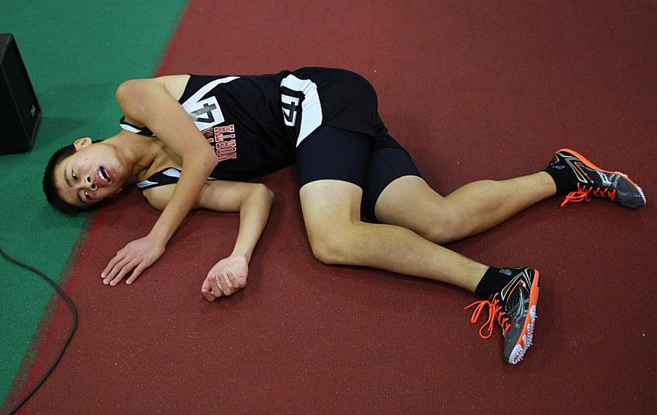 Newton North's Yongyi Zhao tries to catch his breath after his leg of the 4 x 800 relay.