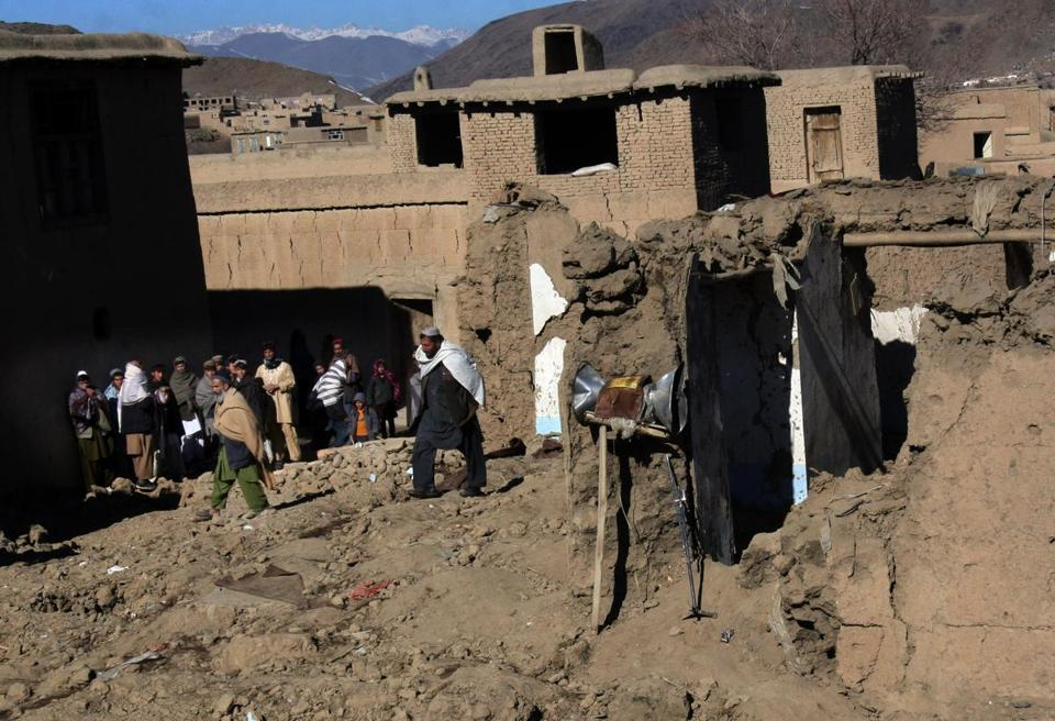 People examined a damaged mosque following an explosion in Sayd Abad district in Afghanistan.