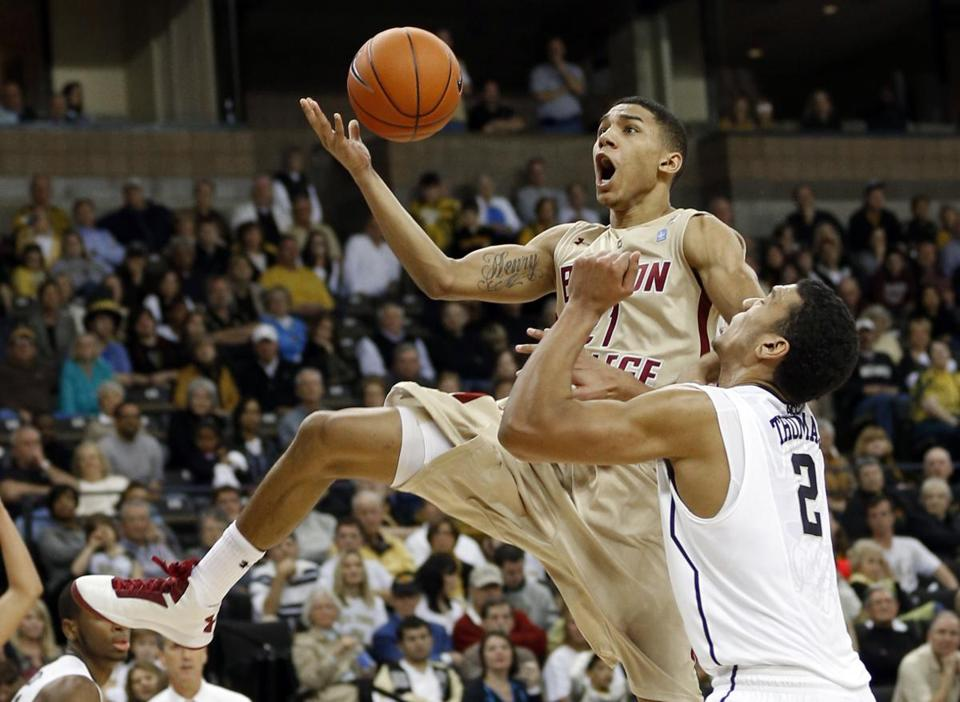 BC's Olivier Hanlan is fouled by Wake Forest's Devin Thomas while driving to the basket during the second half.