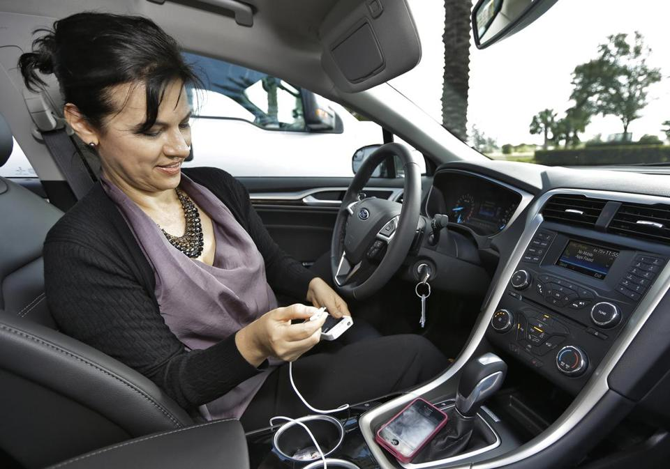 The app brings coupons to drivers of newer Fords and Lincolns who use the voice-controlled Sync AppLink.