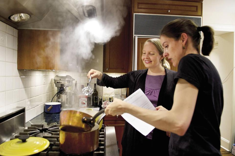 Merrill Stubbs (rear) and Amanda Hesser in the kitchen.