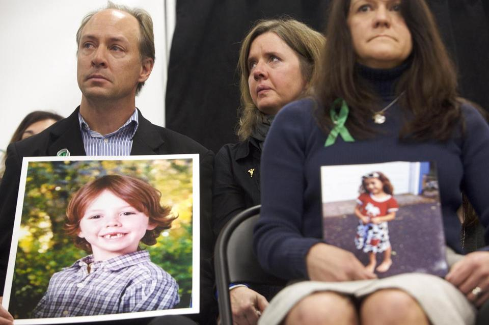 Mark Barden (lef) and Jennifer Hensel (right) held photos of their children Daniel Barden, and Aville Richman, respectively,  during the launch of The Sandy Hook Promise, a non-profit created in response to the Newtown shootings.