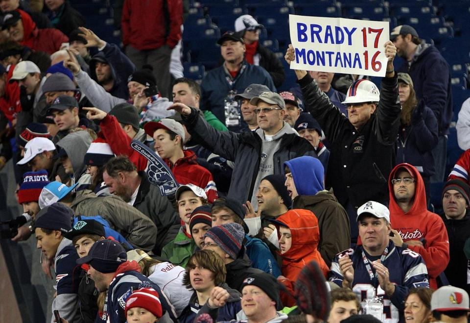 Fans saluted Tom Brady's achievement as he left the field on Sunday night.
