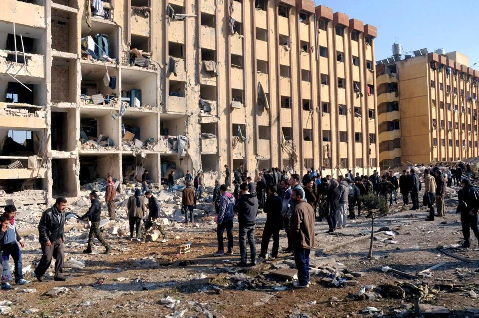 People gathered at the site of an explosion at a university in Aleppo, Syria.