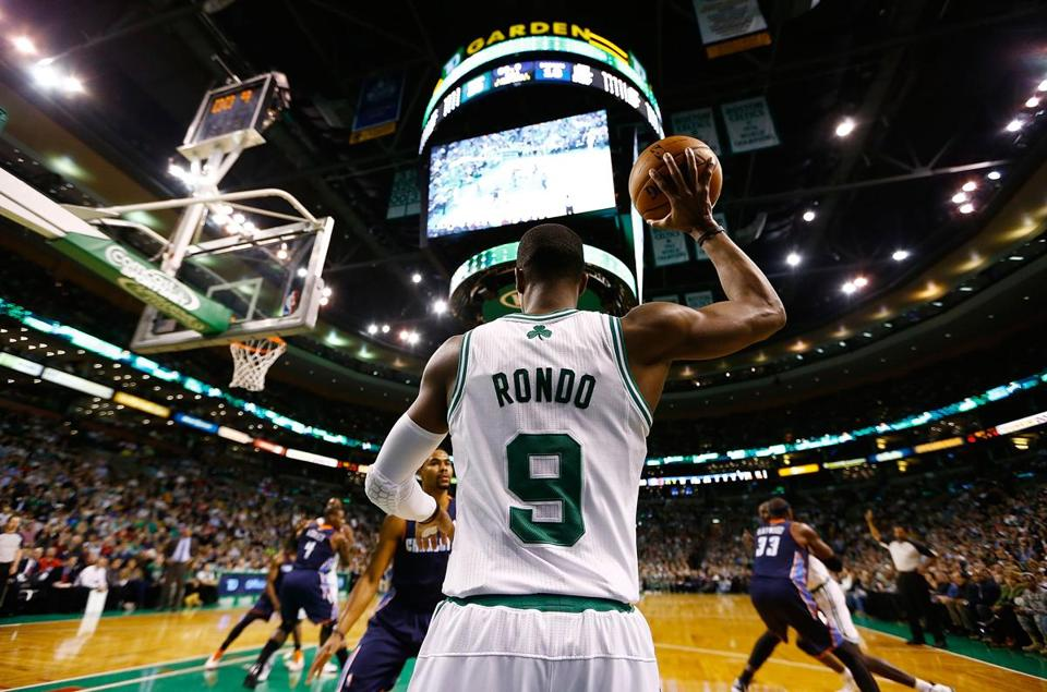 Rajon Rondo looked to throw a pass in a game against the Charlotte Bobcats on Jan. 14 at the TD Garden in Boston. Rondo will miss the rest of the regular season with a knee injury.