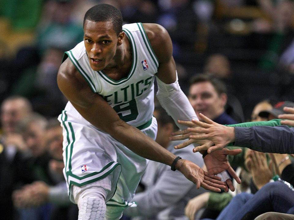 Rajon Rondo capped his triple-double by hitting a shot late in the game, and as he headed back upcourt, he slapped hands with fans.