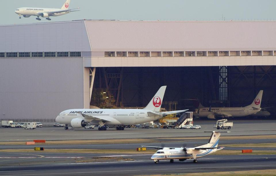 A Japan Airlines Boeing 787 Dreamliner is seen grounded at Haneda airport in Tokyo, Japan.