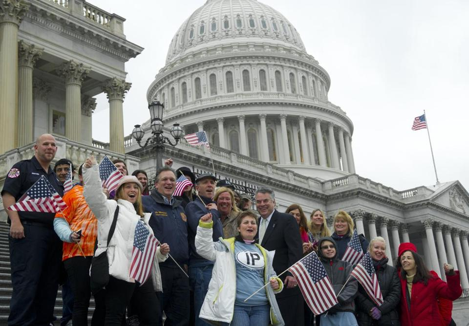 Representative Peter King (center), Republican of New York, rallied Tuesday in support of the Sandy relief bill with first responders and victims of the storm on the US Capitol steps.