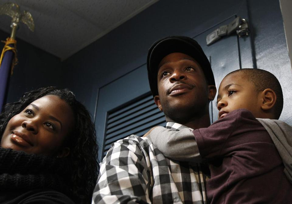 Nelson Mandela Myers (seen with his son and wife) called police after finding an abducted child in a playground.