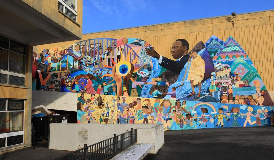 This mural on the Martin Luther King Jr. School in Cambridge will be preserved — either all or part of it — when the new school is built.