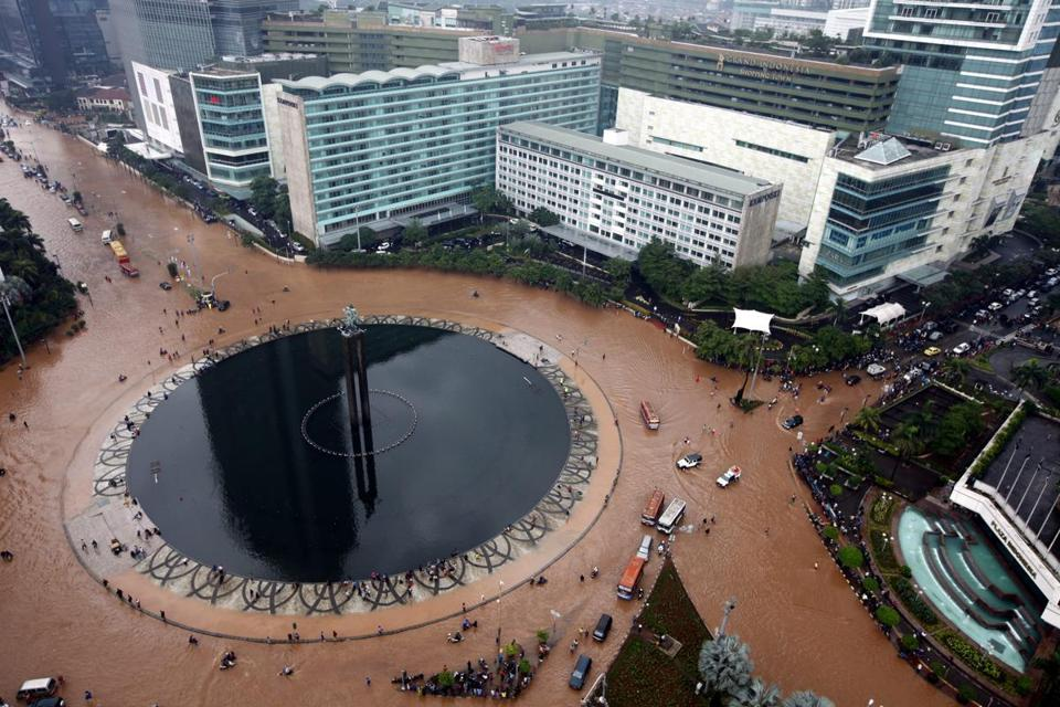 Heavy rains left Jakarta flooded on Thursday. Drainage is poor in the city with 13 rivers. Weather forecasters expect rain to continue for three days.