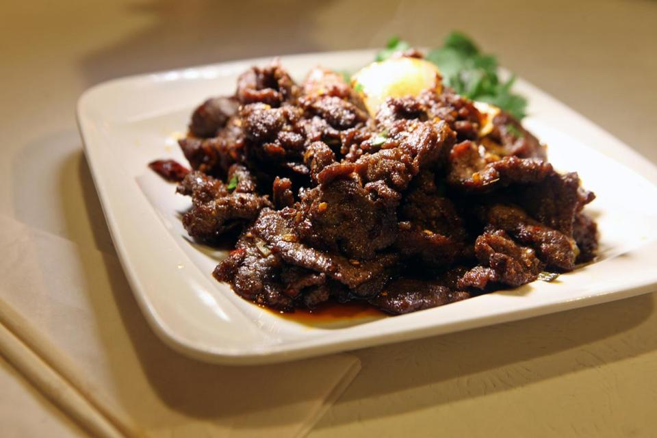 Cumin flavored beef with chili sauce.